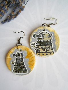 EX-TER-MIN-ATE!  Dalek earrings! Modeled from air dry clay, hand painted with acrylic paints, finished with a clear glaze;  though I see myself making them in Shrinky Dink form too.  Love them!