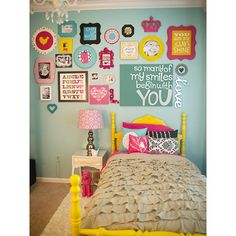 Love all the color! These frames will look so good with the sparkling bright blue walls n the girls room.