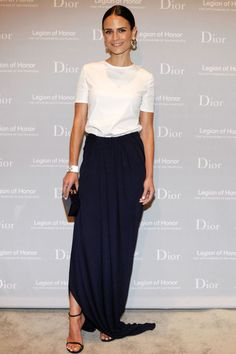 Who: Jordana Brewster What: A Black Maxi Skirt Why: The actress is refined in a long black skirt, worn with a white tee, statement earrings, an Edie Parker clutch and minimal black shoes—it's separates that add up to a streamlined look. Get the look now: T by Alexander Wang skirt, $380, shopBAZAAR.com.