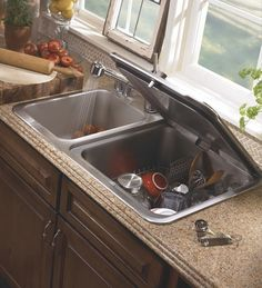 The lid doubles as a draining board, and the unit comes with a snap-on cutting board custom-fitted to the top to further enhance the usability of this surface area. It is well-organized inside with a larger-than-average silverware basket, capacity-expanding capabilities for larger and awkwardly-shaped pots or pans.
