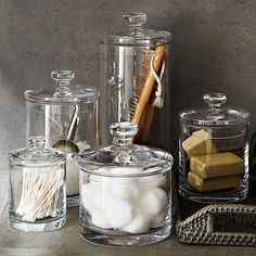 Shop Set of 3 Glass Canisters. Simple bathroom storage with a retro feel. Handmade glass canisters with nesting lids update a classic apothecary look. Simple Bathroom, White Bathroom, Modern Bathroom, Small Bathrooms, Master Bathroom, Neutral Bathroom, Parisian Bathroom, Lavender Bathroom, Bling Bathroom