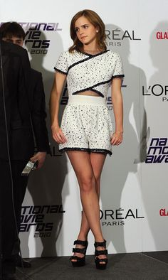 """""""Emma Watson Cutout Dress"""" -   Emma Watson attended the 2010 National Movie Awards in a Spring 2010 dress, which she paired with Chrisitian Louboutin heels.  Brand: Karl Lagerfeld"""