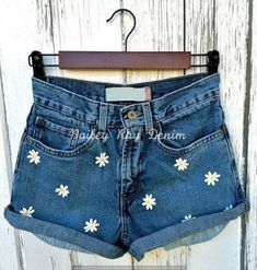 Embrace festival style with embroidered denim cutoffs. The post Embrace festival style with embroidered denim cutoffs. appeared first on Jeans. Levi Shorts, Levi High Waisted Shorts, Distressed High Waisted Shorts, Vintage High Waisted Shorts, Waisted Denim, Ripped Shorts, Ripped Denim, Distressed Denim, Festival Shorts