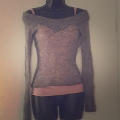 Gray knitted sweater pink tank top underneath Always received compliments in the sweater it's very cute Sweaters