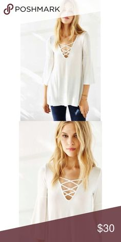 Ecote Bonita Plunge Tunic Top in Ivory NWT. A beautiful, flowy white top with on trend criss crossing straps in the front. Purchased from Urban Outfitters. Price is pretty firm. Urban Outfitters Tops Tunics