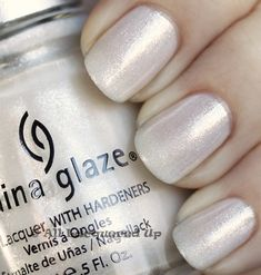 china glaze frosty swatch holiday 2010 China Glaze Holiday 2010   Gold, Silver & White Swatches, Review & Comparisons- It's a creamy white with smooth glitter that becomes opaque with three coats.  The glitter is like a mini version of that flaky glitter we talk about in Nfu Ohs.  It lays flat but reflects light extremely well resulting in a high sparkle polish.