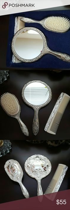 Silver Plated Brush, Mirror and Comb Still in its original case. This set has never been used. Mirror does have a very tiny black spot on the top right corner.  It's barely visible in picture 4. Perfect gift for the Queen/Princess of your life.  Priced on ebay for 99$ and up Accessories