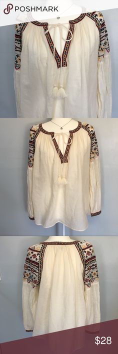 Zara Embroidered Blouse Size XS This Trafaluc Line Peasant Top Blouse is beautiful. It has a gorgeous Egyptian style embroidery flowing from the shoulders to the top of the arms. And trim around the collar and down the V-Neck. Very flowy, comfortable, boho chic. Great preloved condition. Size xs but imo would fit a small. Zara Tops Blouses