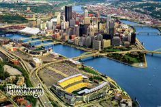 Postcard from Pennsylvania, USA ~ Pittsburgh ~ Aerial view of downtown Pittsburgh, Pennsylvania, and the city's two stadiums: Heinz Field (foreground) and PNC Park (middle left). www.postcrossing.com