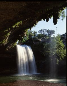The 50-Foot waterfall at Hamilton Pool spills over the enormous limestone grotto that forms the great swimming hole. (Photo by Michael A. Murphy) (Texas Highways)
