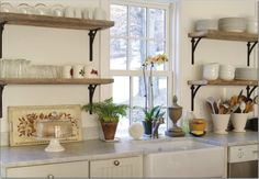 The shelving brackets.  honed+marble+cote+de+texas.jpg (800×554)