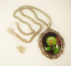 Madame Leota Sees All - The Haunted Mansion Glass Bubble Dome Magnified Huge Pendant Necklace by Twisted M.O.M.. $21.00, via Etsy.