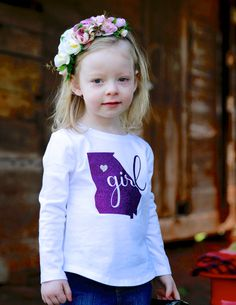 Share your state pride with a Georgia toddler tee! Featuring sparkly glitter design on a high quality toddler tee.
