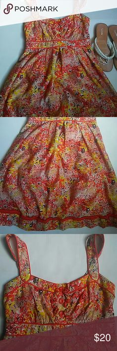 """Jessica Simpson Summer Dress Orange Flower Print Jessica Simpson Summer Dress. Orange Flower Print. Condition: New never worn- without tags. Style: Casual Summer Dress. Size: 2. Material: 65% rayon, 35% nylon. Measurements:  length 34"""", width 13 2/4"""". Jessica Simpson Dresses Midi"""