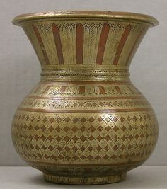 Brass vase with copper inlay, made in Thanjavur, India, in the second half of the 19th century. So-called inferior metals were combined in such artful ways that their relative humbleness (compared to silver and gold) was greatly obscured. A humble masterpiece of the South Asian metalworkers' art.
