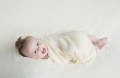 Baby Photos by Jo Frances Wellington, Award Winning Photographer - Adorable baby wrapped in wool, laughing at camera, by Jo Frances