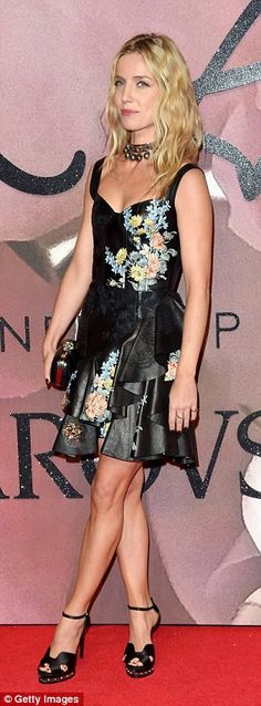 Glamorous: Annabelle displayed her slender legs in the leather look number, boasting a qui...