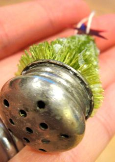 Use an old S lid for the base of a bottle brush tree