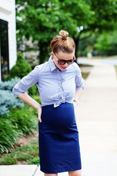 Idea: Put the button up shirt over a dress and tie it right above your bump.