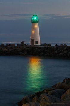 Walton Lighthouse on the west jetty of Santa Cruz Harbor California at twilight.