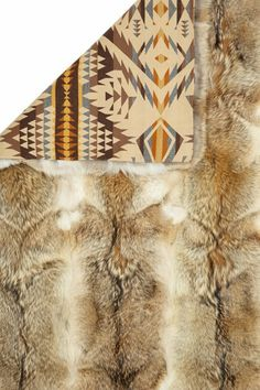 Coyote Fur Throw... This one is real... no thanks. Something that's faux that looks like it would be perfect though.