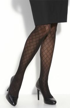 "Spanx ""Trinket"" tights.  Classy with gloss black pumps and a wool skirt."