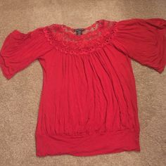 Red medium But fits like a large XL shirt Very detailed size medium red shirt with lace around the neck. Super comfy and the slimming. I wear XL shirt and this size medium fits me so it runs big. Simply irresistable Tops Blouses