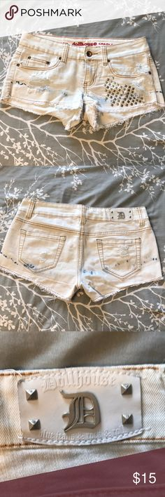 White Distressed Shorts 💋 White Distressed Shorts 💋 size 5, distressed (as pictured) with square studs on the left. All studs are original.  Thanks for shopping my closet!! 🌻💋 Dollhouse Shorts Jean Shorts