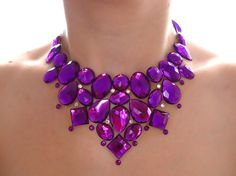 Handmade bright purple rhinestone statement bib necklace created with sparkly and shimmery jewels! Great for casual or formal wear. This beautiful purple rhinestone necklace is fully adjustable with a bright purple satin ribbon. I adore this bold color and it truly shimmers and sparkles more than you can tell from the photos! Each stone is set onto sheer netting to create an elegant and seamless look! When preparing for shipment, I place each necklace onto a sturdy backing, and wrap the…