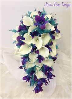 Teal, purple, blue and white bridal wedding teardrop bouquet with lilys, orchids and tufts of teal feather