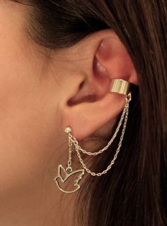 Silver ear cuff with thin chain and a thin bird outline charm
