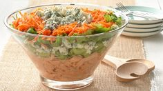 Layer up this beautiful salad with classic buffalo chicken flavors for your next party! Use our Make-Ahead Shredded Chicken Breast pulled from your freezer. Just thaw six cups of the chicken for this salad.