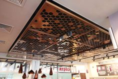 Laser cut screens - Costa Coffee, Heathrow Airport - Suspended ceiling by Miles and Lincoln. www.milesandlincoln.com