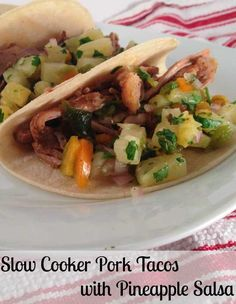 Recipe for Slow Cooker Pork Tacos with Pineapple Salsa - A little bit messy, a whole lot delicious! These Slow Cooker Pork Tacos with Pineapple Salsa are easy to make and have such incredible flavor.