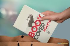 Photorealistic paperback mockup of paperback book being put in to shopping bag | 15 Photorealistic Paperback Book Cover Mockups by ZippyPixels #paperback #book #coverdesign #mockup #psd #photorealistic