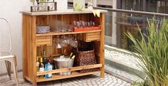 Out door mini bar from World Market.  Would be nice for house parties. City Scenes: Urban Outdoor Living | World Market