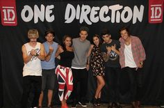One Direction m The boys with two fans. And OMG Niall's wearing a basket on his head bahahaga
