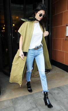 Kendall Jenner throws a long olive green kimono over a simple jeans and tee look