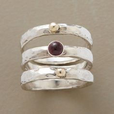 PLANETARY STACK RINGS--Like a rare alignment of planets, 14kt gold beads line up with a garnet cabochon. Handmade exclusive. Set of 3 in sterling silver