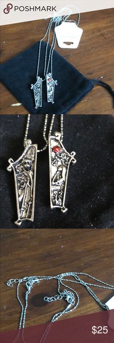 Jack and Sally necklaces Brand new. 2 piece set. Necklaces- one has Jack and the other Sally. Silverplated. 18 inches Jewelry Necklaces