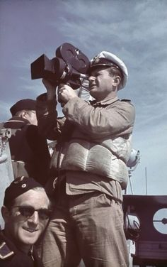 Kriegsmarine cameraman with Arriflex 35mm camera