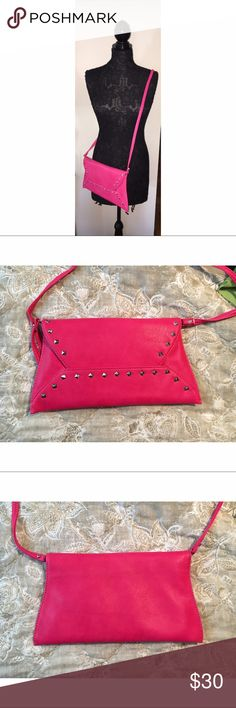 NEW Hot Pink Studded Purse This purse is in perfect condition! It has a a removable strap so you can wear it like a crossbody or use it as a clutch. It has a beautiful yellow, white and black satin-y material on the inside. Bags Clutches & Wristlets