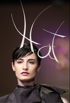 Hat by Philip Treacy (of course). Modelled by the indomitable Erin O'Connor