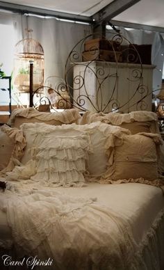 rustic romance, love the linens and love the headboard!!!