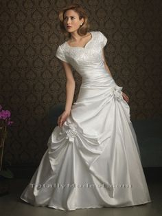 "The skirt of this dress, mostly because the flowers and the ""Ball gown"" type design."
