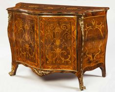 A Marquetry Commode attributed to Pierre Langlois was of French Hunguenot Extraction he extraordinarily successful, working for some of the most distinguished patrons in the country. Examples of his work may still be seen in several great country houses, as well as at Buckingham Palace and Windsor Castle. The quality and elaboration of this commode declares a client with no cause to spare expense. English, Circa 1765-70