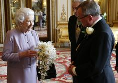 A replica of the Coronation Bouquet is presented to Queen Elizabeth II by the…