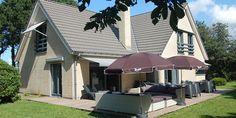 Luxe vakantiehuis voor grote gezinnen met 12 personen op nieuw park nabij het strand van Ouddorp, met 6 slaapkamers, 2 badkamers en een heerlijke groteloungeset op het terras!