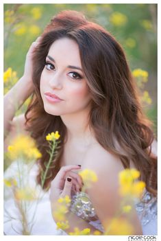 senior portrait posing idea for girls - closeup in flower field in formal dress