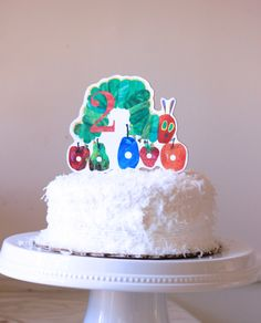 Very Hungry Caterpillar Custom Wooden Cake Topper for Birthday by MarieRoseDecorations on Etsy https://www.etsy.com/listing/200242850/very-hungry-caterpillar-custom-wooden